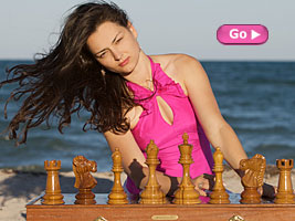 World Chess Champion Alexandra Kosteniuk photos on the beach