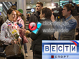 Chess Grandmaster Alexandra Kosteniuk is featured on TV at her arrival at Moscow Airport after her success in Crete at the European Team Championshps