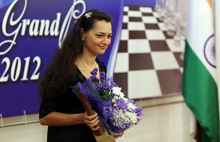Chess Queen™ Alexandra Kosteniuk getting her prize