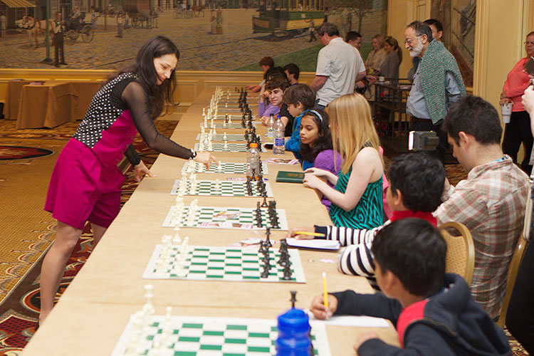 Chess Queen Alexandra Kosteniuk gives a simul at the SuperNationals in Nashville